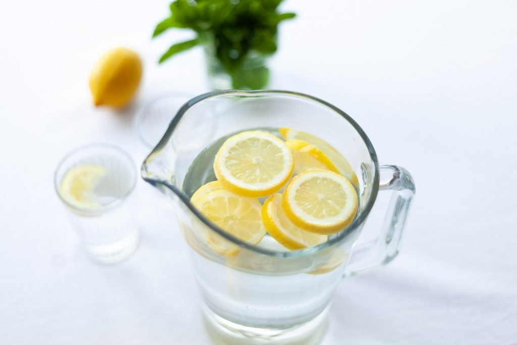 Pitcher of cool water with fresh lemon.