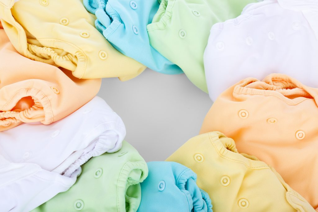 Assorted colors of cloth diapers. Cloth diapers help in reducing waste.